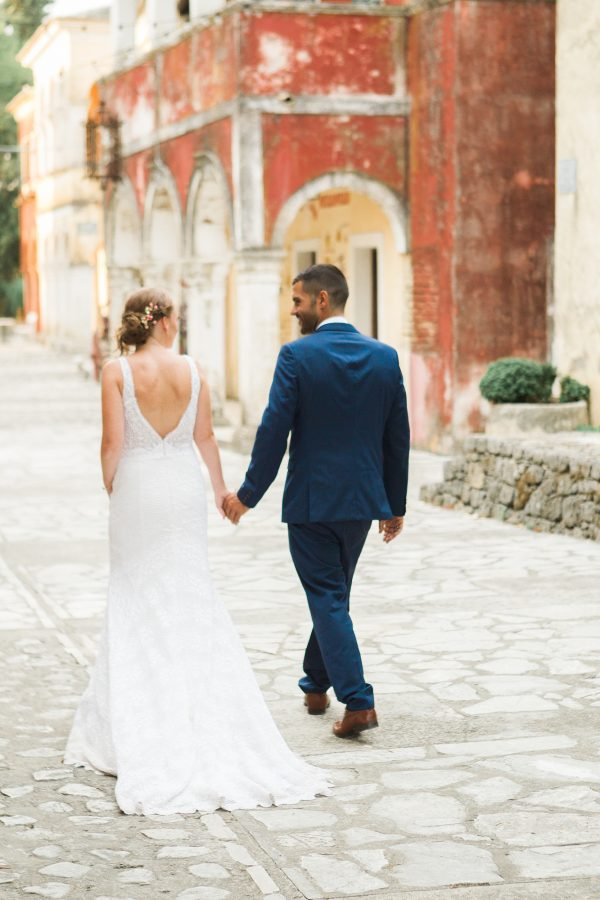 bride-and-groom-walking-in-an-old-village