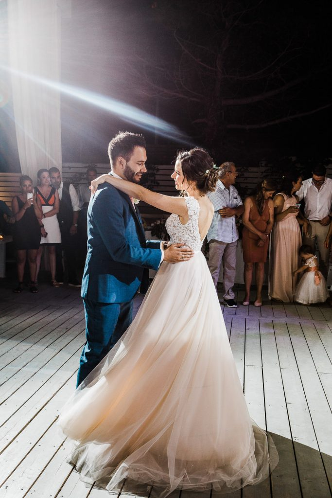 Bride and groom dancing in the center of the wooden floor.