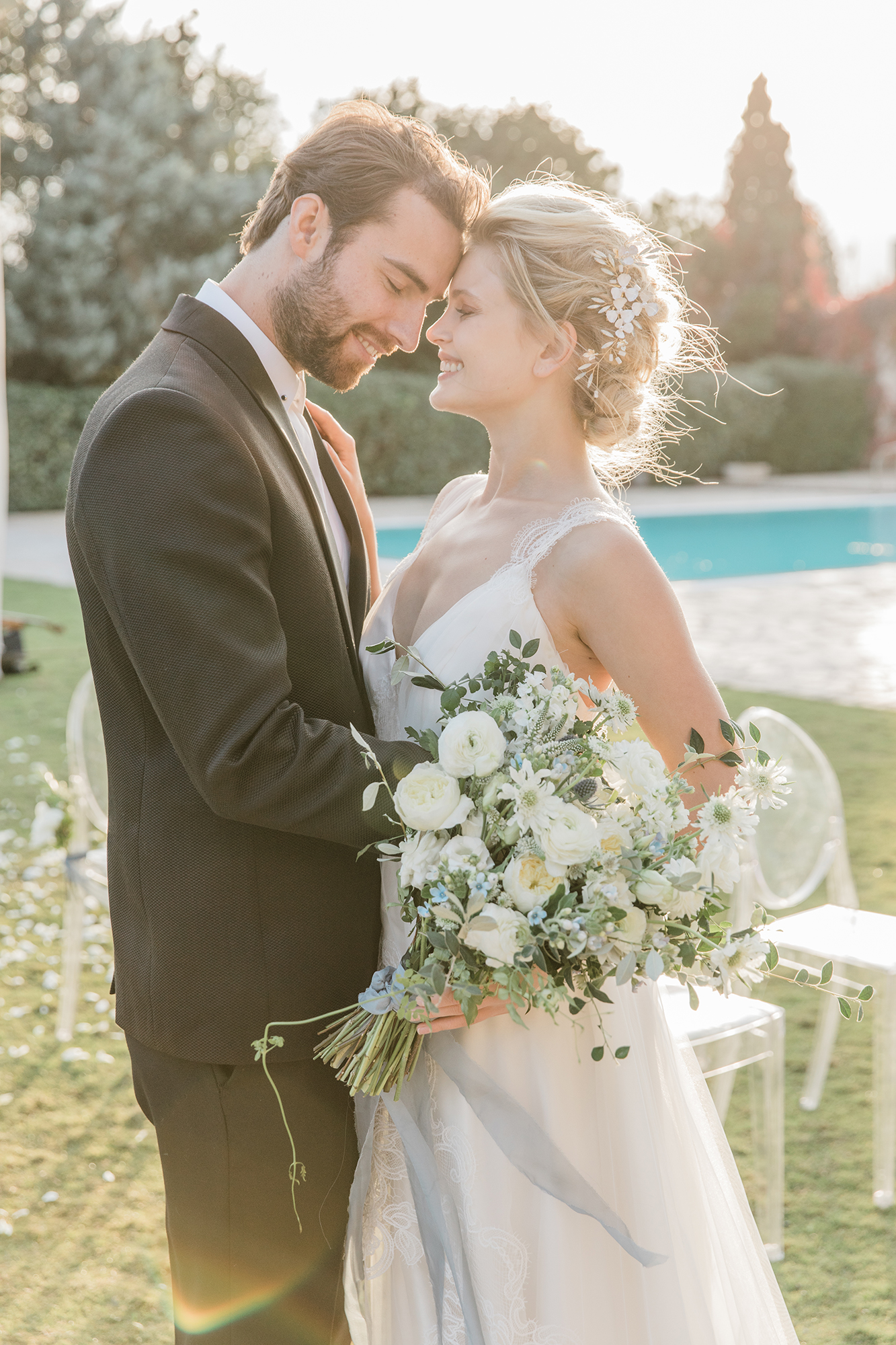bride-and-groom-hugging-each-other-in-a-beautiful-yard